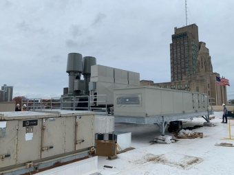 technicians-on-roof-with-equipment