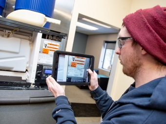 medford-technician-taking-picture-with-ipad