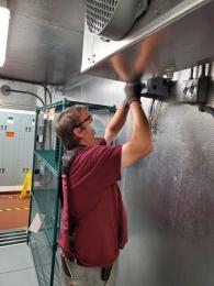 technician-adjusting-refrigerator