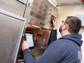 technician-checkinng-refigerator-temperature