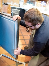 technician-fixing-refrigerator-door-lining