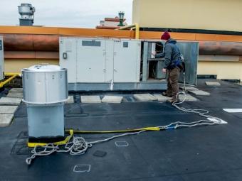 technician-in-harness-on-roof