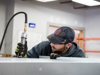technician-grinding-sheet-metal